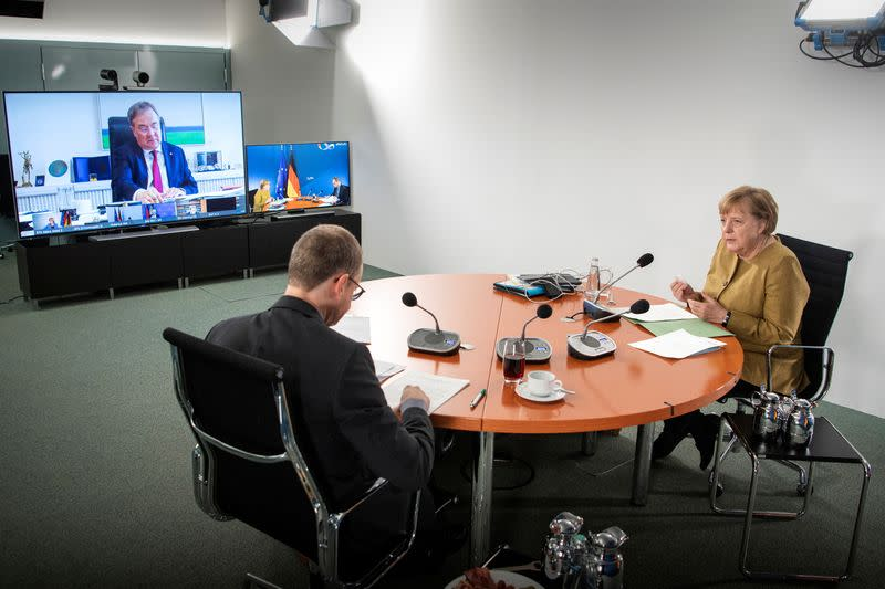 FILE PHOTO: German Chancellor Angela Merkel attends video consultations with the premiers of Germany's 16 federal states