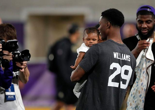 "LSU cornerback Andraez ""Greedy"" Williams holds his daughter, Khloe. (AP Photo)"