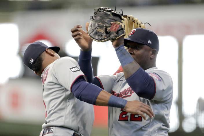 Minnesota Twins' Miguel Sano, right, catches a fly ball while colliding with Jorge Polanco during the second inning of an Opening Day baseball game against the Milwaukee Brewers Thursday, April 1, 2021, in Milwaukee. (AP Photo/Aaron Gash)