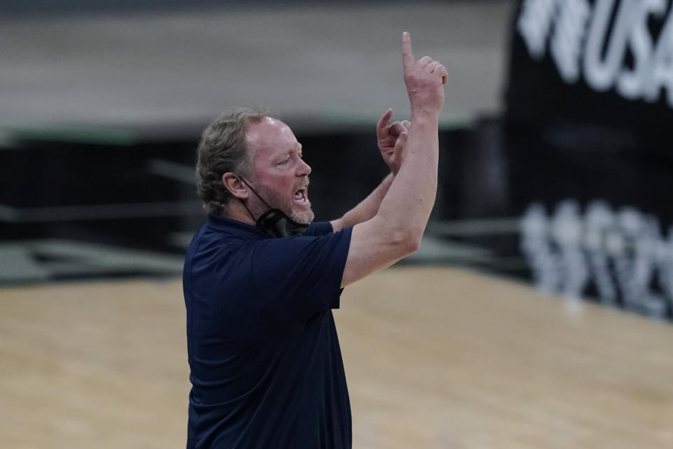 Milwaukee Bucks head coach Mike Budenholzer signals to his players during the second half of an NBA basketball game against the San Antonio Spurs in San Antonio, Monday, May 10, 2021. (AP Photo/Eric Gay)