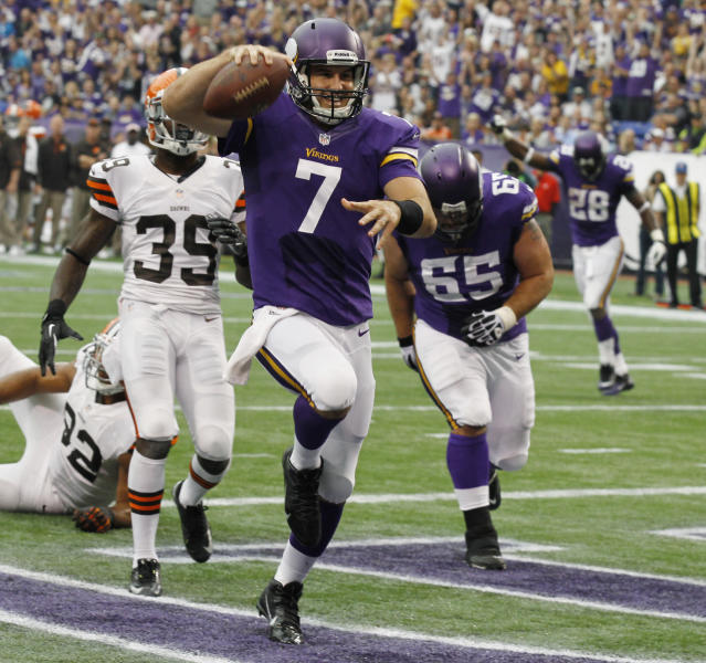 FILE - In this Sept. 22, 2013 file photo, Minnesota Vikings quarterback Christian Ponder (7) celebrates after scoring on a 6-yard touchdown run during the first half of an NFL football game against the Cleveland Browns, in Minneapolis. Ponder has come full circle for the Vikings. He made his first career start against Green Bay, and now after being benched this season for a few weeks he's back in command of the offense with the Packers coming to town. (AP Photo/Ann Heisenfelt, File)