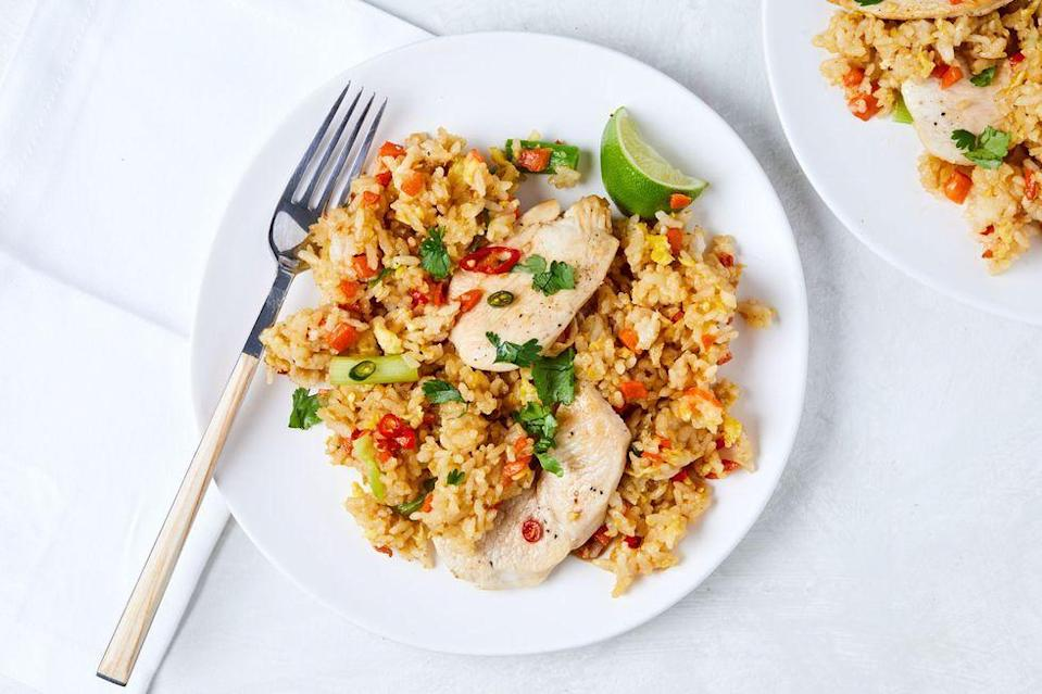 """<p>Pro tip: Freeze your chicken for about 10 minutes and you'll be able to slice your chicken super thin! </p><p>Get the <a href=""""https://www.delish.com/uk/cooking/recipes/a35317097/thai-fried-rice-recipe/"""" rel=""""nofollow noopener"""" target=""""_blank"""" data-ylk=""""slk:Thai Chicken Fried Rice"""" class=""""link rapid-noclick-resp"""">Thai Chicken Fried Rice</a> recipe.</p>"""