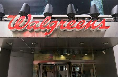 FILE PHOTO: The Walgreens logo is seen outside the store in Times Square in New York