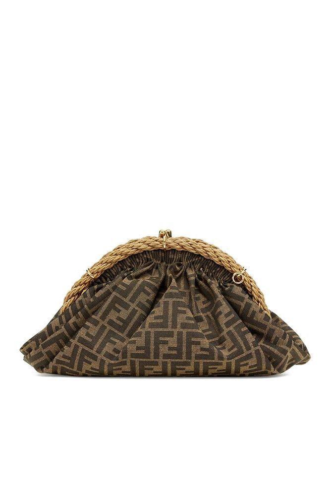 """<p><strong>Fendi</strong></p><p>fendi.com</p><p><strong>$2850.00</strong></p><p><a href=""""https://www.fendi.com/us/bags/woman/clutches-and-pochettes/p-8bp121afkcf0a6e"""" rel=""""nofollow noopener"""" target=""""_blank"""" data-ylk=""""slk:SHOP IT"""" class=""""link rapid-noclick-resp"""">SHOP IT</a></p><p>Since the newer style of the clutch that just came down the runway will not be out for a few months, try this classic double-F logo print version now.</p>"""