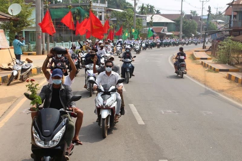 People take part in a motorcycle parade during a protest against the military coup, in Launglon township