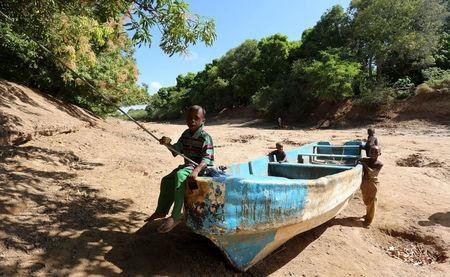 FILE PHOTO: Children play on an abandoned boat along the Shabelle River bed, which is dry due to drought in Somalia's Shabelle region, March 19, 2016. REUTERS/Feisal Omar/File Photo