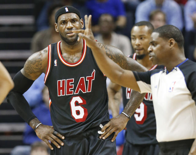 Miami Heat forward LeBron James (6) reacts to an official's call in the first half of an NBA basketball game Wednesday, April 9, 2014, in Memphis, Tenn. (AP Photo/Mark Humphrey)