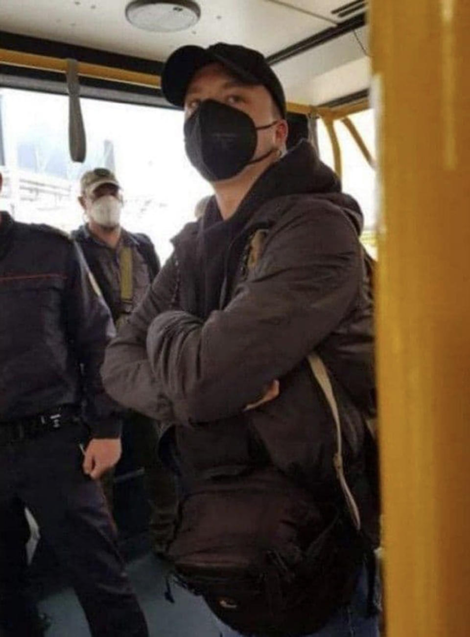 FILE - In this photo released May 23, 2021, by telegram Chanel t.me/motolkohelp, Belarus journalist Raman Pratasevich wearing a face mask, stands in an airport bus in the international airport in Minsk, Belarus. As he was returning Sunday to the Lithuanian capital of Vilnius from Greece with his girlfriend aboard a Ryanair jet, Belarusian flight controllers told the crew to divert to Minsk, citing a bomb threat. Pratasevich was arrested after the plane landed. (telegram Chanel t.me/motolkohelpp via AP, File)