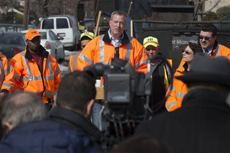 New York Mayor de Blasio speaks to the press during a news conference in the Maspeth section of Queens