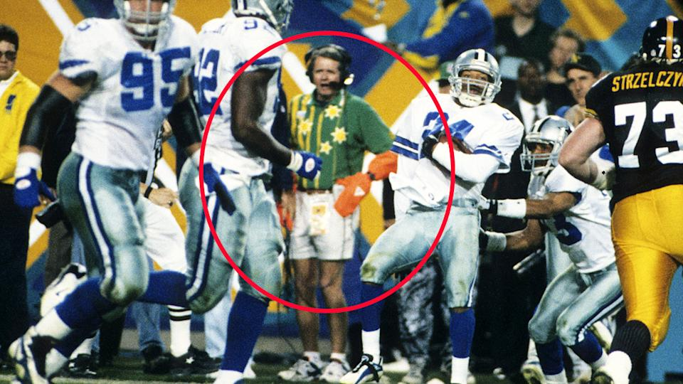 The man, pictured here on the sideline as Larry Brown celebrates his touchdown in the 1996 Super Bowl.