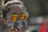 A woman attends a protest in front of the Serbian Parliament building in Belgrade, Serbia, Saturday, April 10, 2021. Environmental activists are protesting against worsening environmental situation in Serbia. (AP Photo/Darko Vojinovic)
