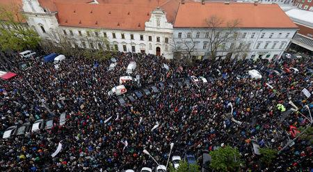 Demonstrators take part in in an anti-corruption rally demanding the resignation of the interior minister and police chief, in Bratislava