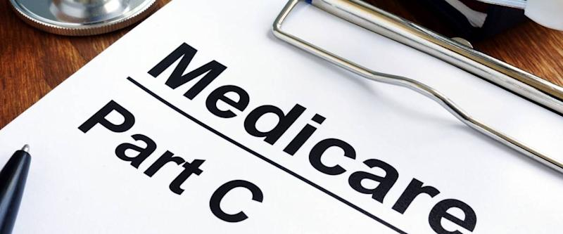Medicare Part C papers, glasses and stethoscope.