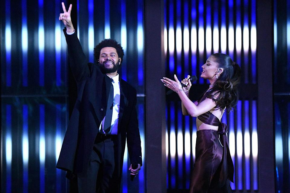 """<p>In May 2021, she <a href=""""https://people.com/music/iheartradio-music-awards-2021-ariana-grande-first-appearance-since-wedding/"""" rel=""""nofollow noopener"""" target=""""_blank"""" data-ylk=""""slk:joined The Weeknd to perform"""" class=""""link rapid-noclick-resp"""">joined The Weeknd to perform</a> their remixed collaboration """"Save Your Tears"""" at the iHeartRadio Music Awards. Weeks later, <a href=""""https://people.com/music/ariana-grande-james-corden-celebrate-covid-lockdown-restriction-lifts/"""" rel=""""nofollow noopener"""" target=""""_blank"""" data-ylk=""""slk:she was back at it"""" class=""""link rapid-noclick-resp"""">she was back at it</a>, performing in a <i>Hairspray-</i>inspired sketch called """"No Lockdowns Anymore"""" with James Corden on<em> The Late Late Show.</em></p>"""