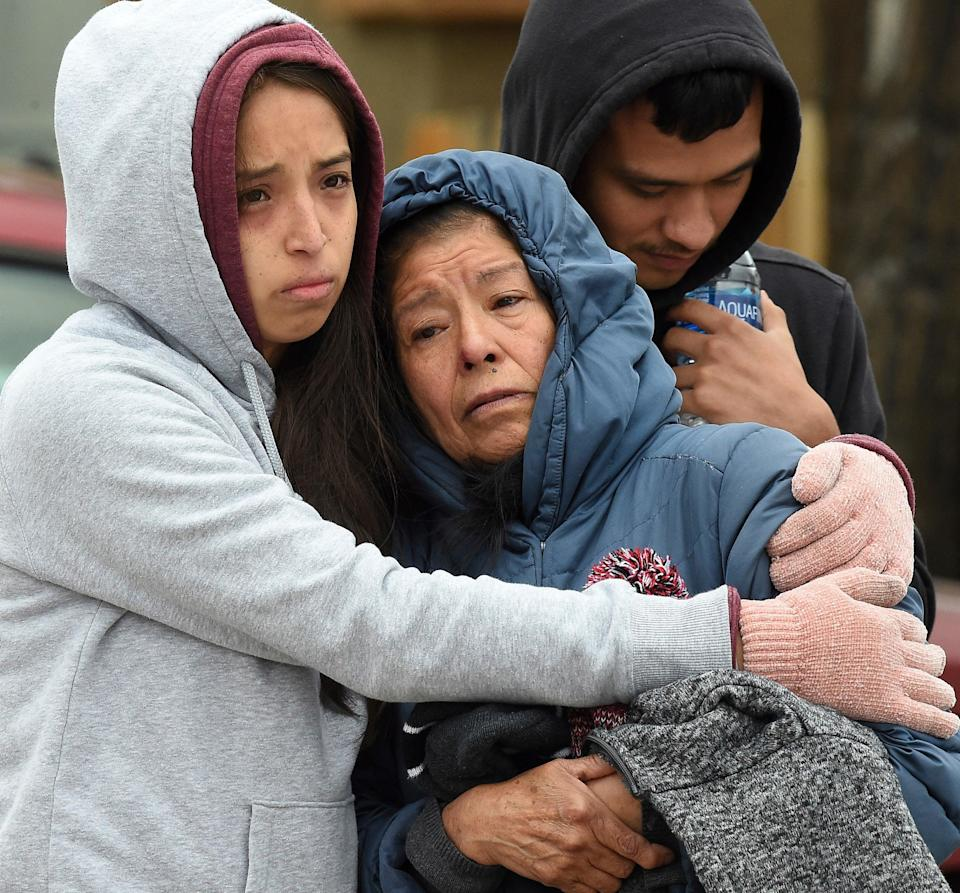 <p>Family members mourn at the scene where their loved ones were killed in Colorado Springs</p> (AP)