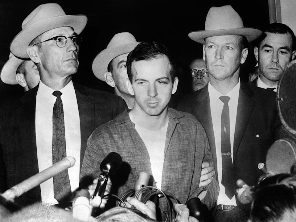 <p>US President John F Kennedy's murderer Lee Harvey Oswald during a press conference after his arrest in Dallas</p> (AFP via Getty Images)