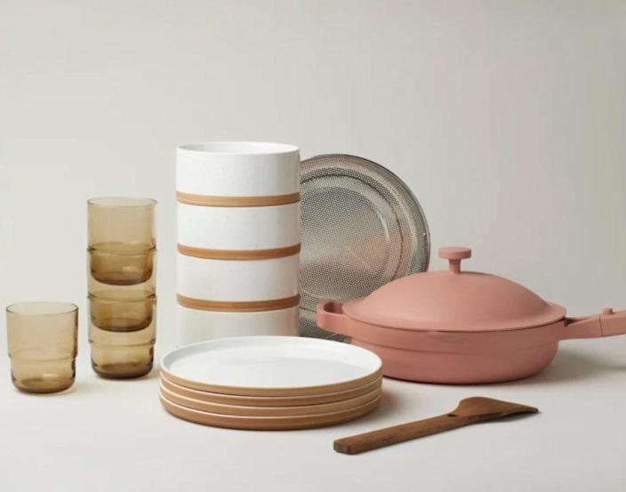 """There's not much they can't do with this Our Place set. The Instagram-famous multipurpose pan sautees, steams, and so much more—but this bundle includes everything else they'll need for dinner at home with friends. $290, Our Place. <a href=""""https://fromourplace.com/products/bundle"""" rel=""""nofollow noopener"""" target=""""_blank"""" data-ylk=""""slk:Get it now!"""" class=""""link rapid-noclick-resp"""">Get it now!</a>"""