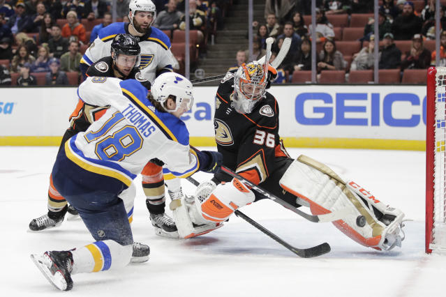 St. Louis Blues' Robert Thomas, left, scores against Anaheim Ducks goaltender John Gibson during the third period of an NHL hockey game Wednesday, March 6, 2019, in Anaheim, Calif. The Blues won 5-4. (AP Photo/Jae C. Hong)