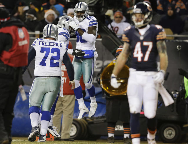 Dallas Cowboys wide receiver Dez Bryant (88) celebrates his touchdown reception with tight end James Hanna during the first half of an NFL football game, Monday, Dec. 9, 2013, in Chicago. At right is Chicago Bears safety Chris Conte (47). (AP Photo/Nam Y. Huh)