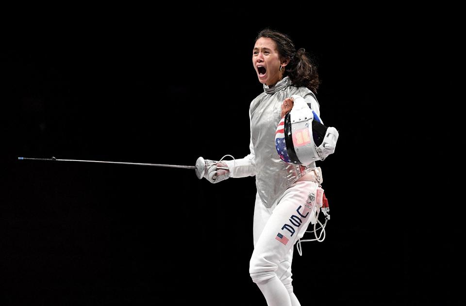 <p>Team USA's Lee Kiefer celebrates as she makes history as the first American woman to win a medal in individual foil. Not only did she place, she won gold at the Makuhari Messe Hall on July 25.</p>