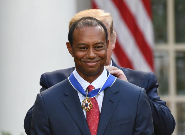 US President Donald Trump presents US golfer Tiger Woods with the Presidential Medal of Freedom during a ceremony in the Rose Garden of the White House in Washington, DC, on May 6, 2019. (Photo by SAUL LOEB / AFP) (Photo credit should read Saul Loeb/AFP/Getty Images)