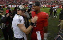 FILE - In this Dec. 9, 2018, file photo, New Orleans Saints quarterback Drew Brees (9) shakes hands with Tampa Bay Buccaneers quarterback Jameis Winston (3) after an NFL football game in Tampa, Fla. Brees, the NFL's leader in career completions and yards passing, has decided to retire after 20 NFL seasons, including his last 15 with New Orleans.(AP Photo/Jason Behnken, File)