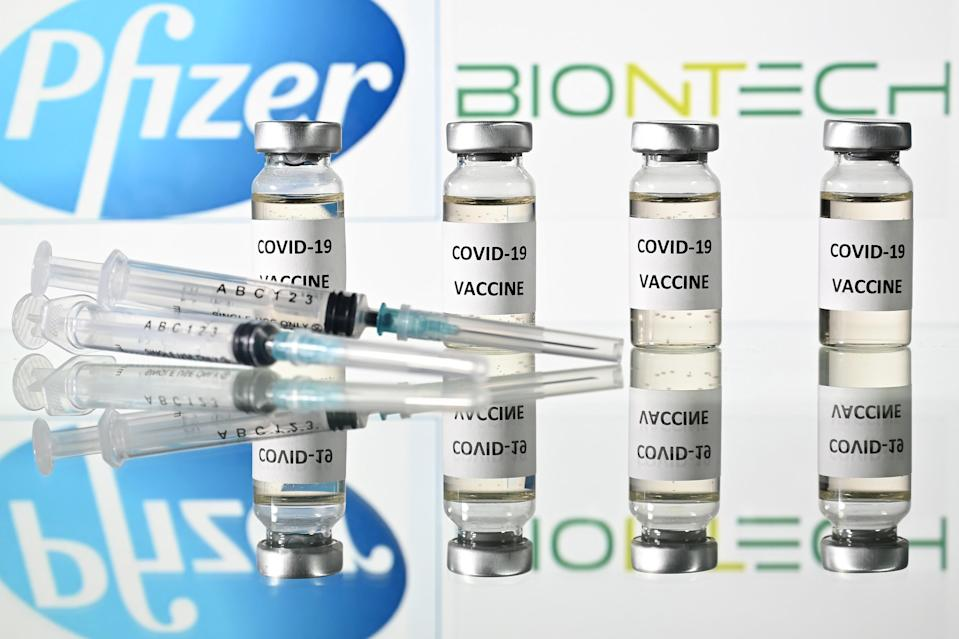 An illustration picture shows vials with Covid-19 Vaccine stickers attached and syringes with the logo of US pharmaceutical company Pfizer and German partner BioNTech, on November 17, 2020. (Photo by JUSTIN TALLIS / AFP) (Photo by JUSTIN TALLIS/AFP via Getty Images)