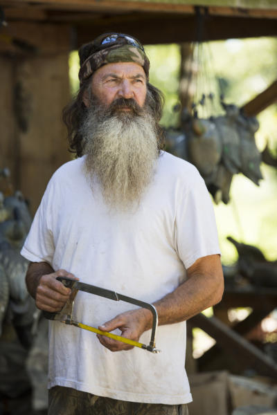 """This undated image released by A&E shows Phil Robertson from the popular series """"Duck Dynasty."""" Robertson was suspended last week for disparaging comments he made to GQ magazine about gay people. (AP Photo/A&E, Zach Dilgard)"""