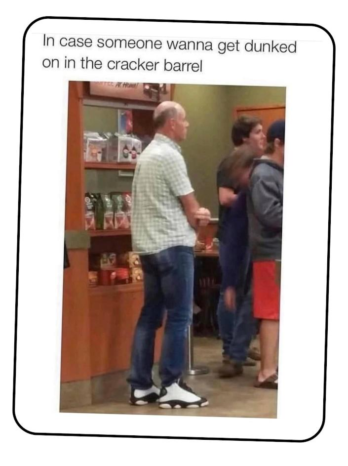 A picture of a middle-aged guy in a drab collared shirt and blue jeans but with flashy basketball high tops.