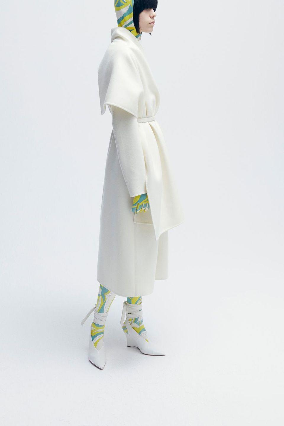 """<p>After a fall and winter where we did such little traveling and jetting and, honestly, living the good life, it's almost cruel to see a collection so clearly made for good wintry days out and about—almost. The prints and colors are as bold and happy as you'd expect, doing honor to Pucci himself who set out to """"Puccify all the seasons"""" after first launching in Capri. These are pieces meant for St. Tropez and St. Moritz, separates designed to be mixed and matched and intended to bring as much energetic delight in snow or sun (don't let the printed leggings fool you—there are shorts and saucily slit skirts too). Consider it the happiest pledge that next resort season will look nothing like the last.<em>—Leah Melby Clinton</em></p>"""