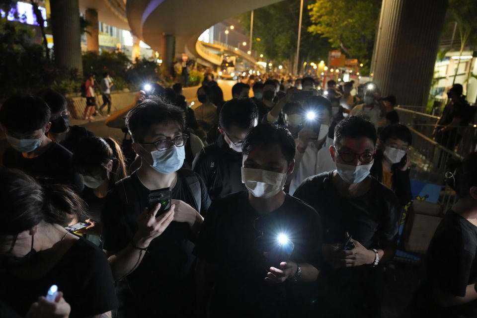 People light LED candles to mark the anniversary of the military crackdown on a pro-democracy student movement in Beijing, outside Victoria Park in Hong Kong, Friday, June 4, 2021. A member of the committee that organizes Hong Kong's annual candlelight vigil for the victims of the Tiananmen Square crackdown was arrested early Friday on the 32nd anniversary. (AP Photo/Kin Cheung)