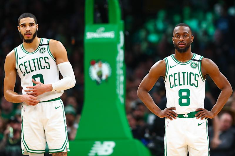 Boston Celtics stars Jayson Tatum and Kemba Walker can further their legacies in Game 7. (Adam Glanzman/Getty Images)