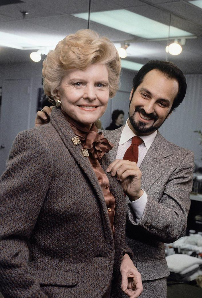 betty ford being fitted for a coat by designer albert capraro in 1981