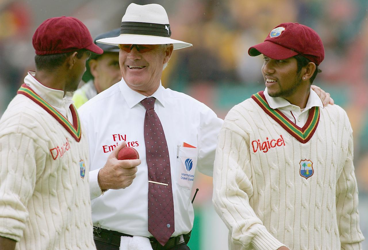 HOBART, TAS - NOVEMBER 18:  Umpire Rudi Koertzen speaks with Shivnarine Chanderpaul (left) and Ramnaresh Sarwan (right) of the West Indies as they leave the field for tea during day two of the Second Test between Australia and the West Indies played at Bellerive Oval on November 18, 2005 in Hobart, Australia.   (Photo by Hamish Blair/Getty Images)