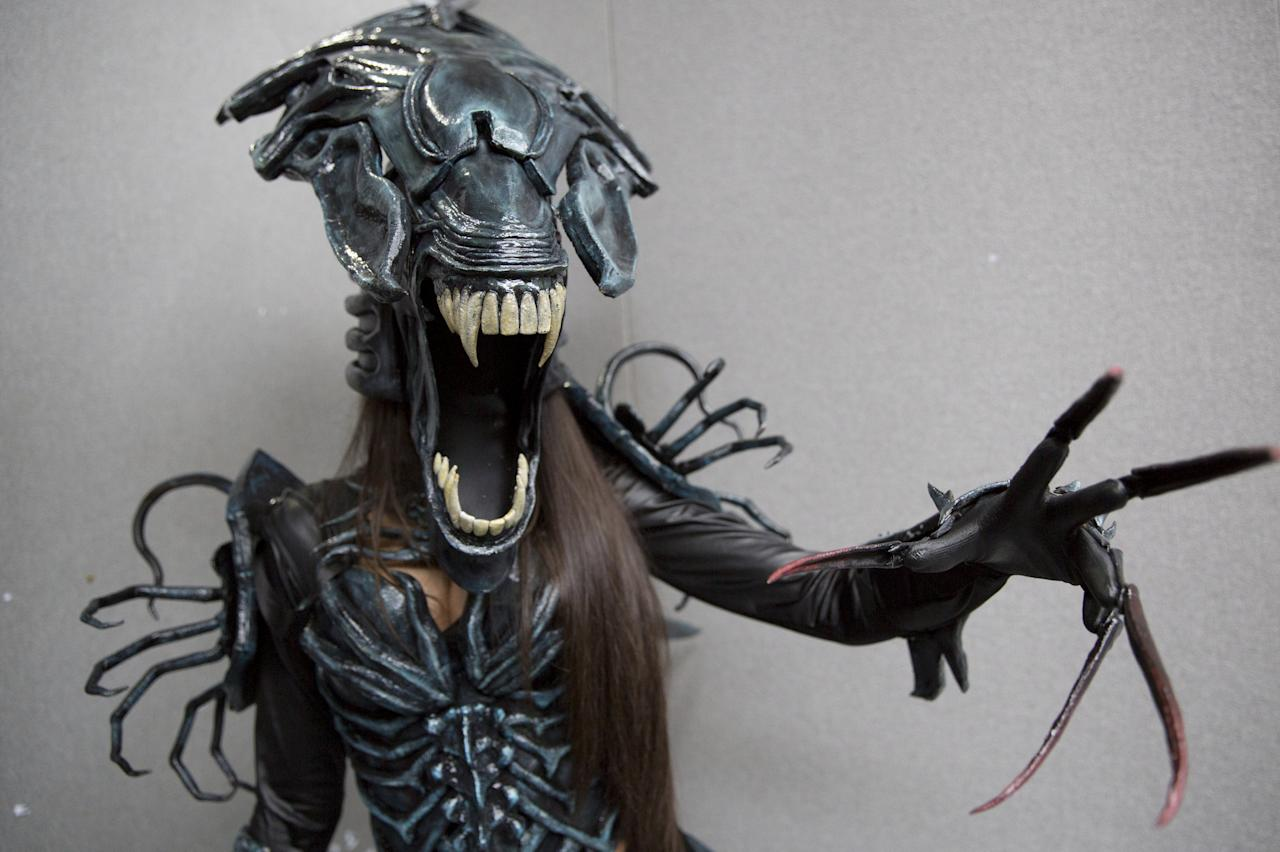 FILE PHOTO: A cosplay fan poses in character as an alien at the London Film and Comic-Con in London, Britain July 17, 2015. REUTERS/Neil Hall/File Photo