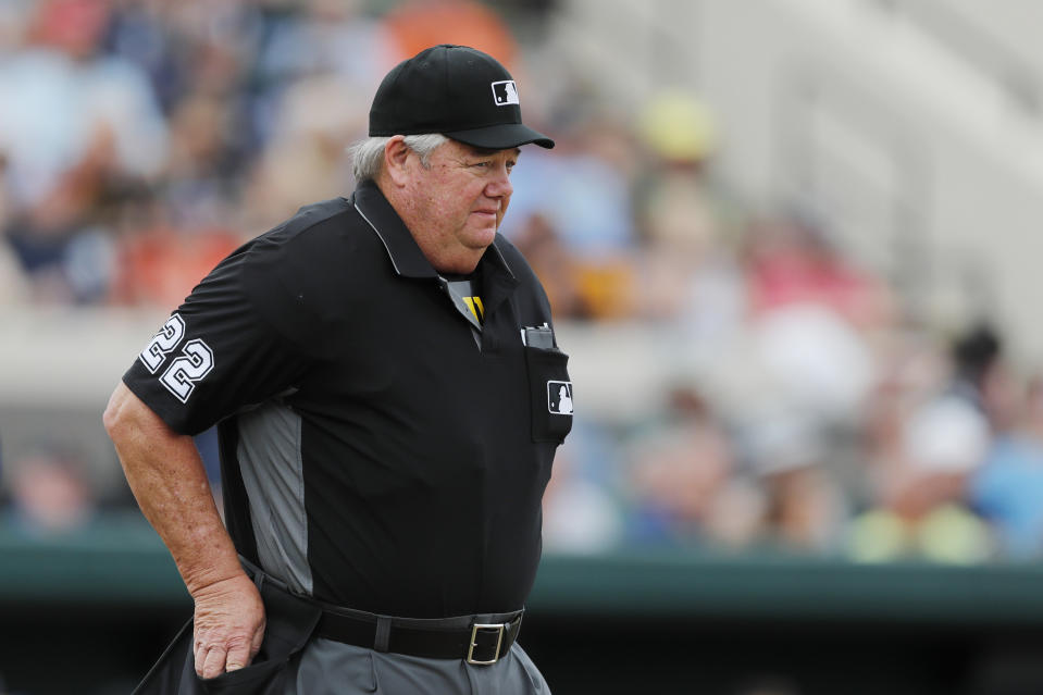 Umpire Joe West is seen during a spring training baseball game between the Detroit Tigers and the Pittsburgh Pirates, Tuesday, March 10, 2020, in Lakeland, Fla. (AP Photo/Carlos Osorio)