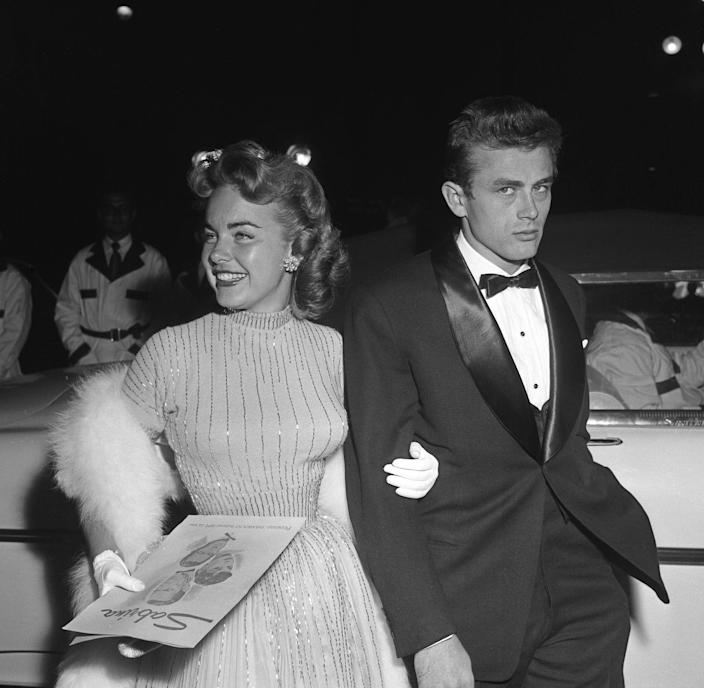 <p>Dean and actress Terry Moore attend the Hollywood premiere of <em>Sabrina </em>together. After the success of <em>East of Eden</em>, Dean was slated to become one of Hollywood's next big stars.  </p>