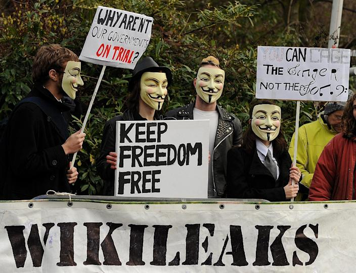 Supporters of WikiLeaks founder Julian Assange gather outside Belmarsh Magistrates' Court, in south-east London, on February 24, 2011 (AFP Photo/Ben Stansall)