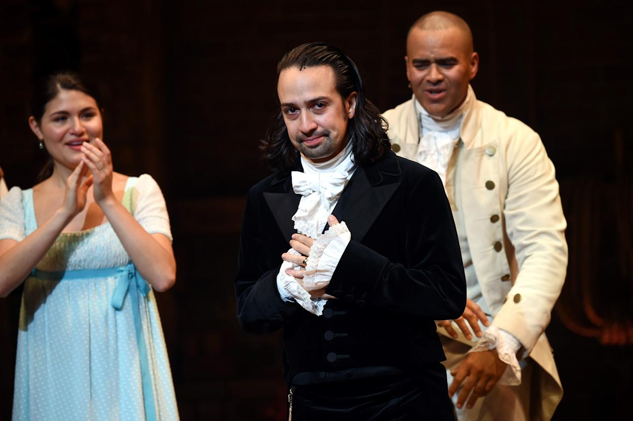 "<em>Hamilton</em> creator and star Lin-Manuel Miranda improvised some new lyrics to one of the musical's songs when he spotted someone using their phone, singing ""Lady filming in the fourth row, please stop it."" (Credit: Invision/AP)"
