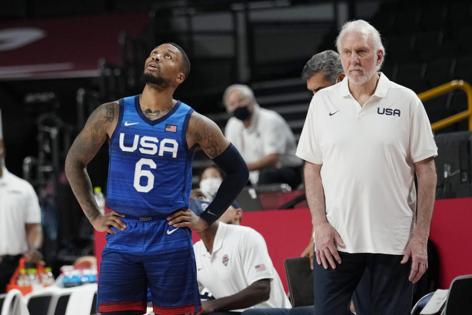 United States' guard Damian Lillard (6) and coach Gregg Popovich, right, wait for a replay to decide possession of the ball during their loss to France in a men's basketball preliminary round game at the 2020 Summer Olympics, Sunday, July 25, 2021, in Saitama, Japan. (AP Photo/Eric Gay)