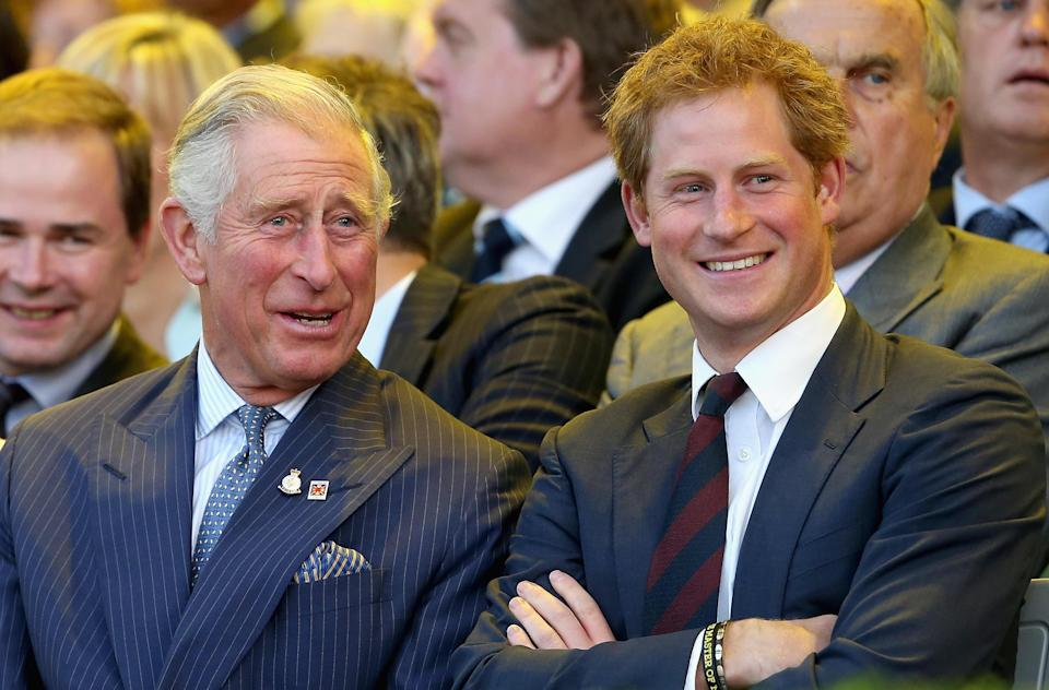 Prince Charles and Prince Harry laugh during the Invictus Games Opening Ceremony on September 10, 2014 in London, England. / Credit: Chris Jackson / Getty Images