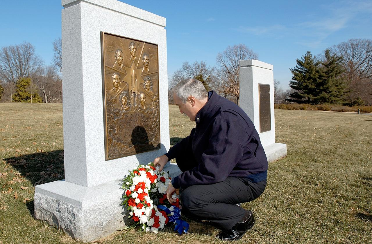 NASA administrator Sean O'Keefe lays a wreath at the Space Shuttle Challenger Memorial January 28, 2003 at Arlington National Cemetery in Virginia. The Challenger exploded shortly after take-off January 28, 1986, killing the entire crew. They are:  Michael Smith, Ronald McNair, Ellison Onizuka, Judith Resnick, Dick Scobee, Greg Jarvis and Christa McAuliffe. O'Keefe also used the occasion to remember the crew of Apollo 1, Roger Chaffee, Ed White and Gus Grissom, who died in a fire on the launch pad on January 27, 1967.  (Photo by Bill Ingalls/NASA/Getty Images)