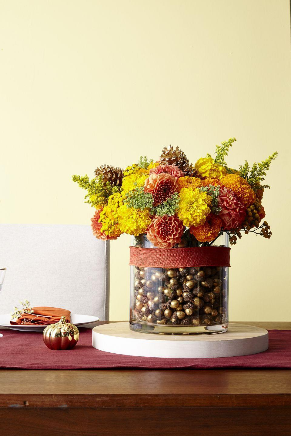 <p>For a no-fuss yet stylish look, add decorative acorns (or real ones) to any vase and let them serve as the base for a lovely bouquet. </p>