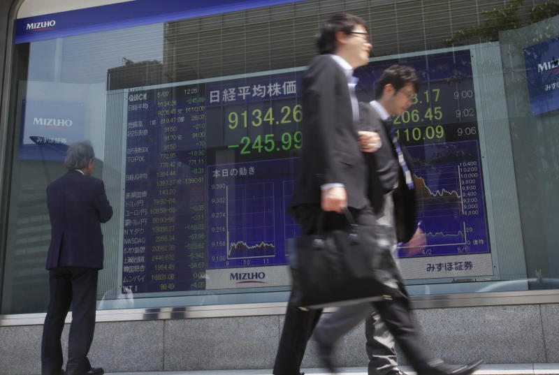 A man watches the securities firm's electronic stock board in Tokyo, Monday, May 7, 2012. Asian stock markets were pummeled Monday by weekend election results in Greece and France that heightened uncertainty about Europe's ability to solve its debt crisis. Japan's Nikkei 225 index plunged 2.6 percent to 9,134.26. (AP Photo/Shizuo Kambayashi)