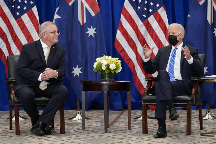 """FILE - In this Sept. 21, 2021, file photo President Joe Biden meets with Australian Prime Minister Scott Morrison at the Intercontinental Barclay Hotel during the United Nations General Assembly in New York. Biden is set to host the first ever in-person gathering of leaders of the Indo-Pacific alliance known as """"the Quad"""" on Friday, wrapping up a tough week of diplomacy in which he faced no shortage of criticism from both allies and adversaries. (AP Photo/Evan Vucci, File)"""