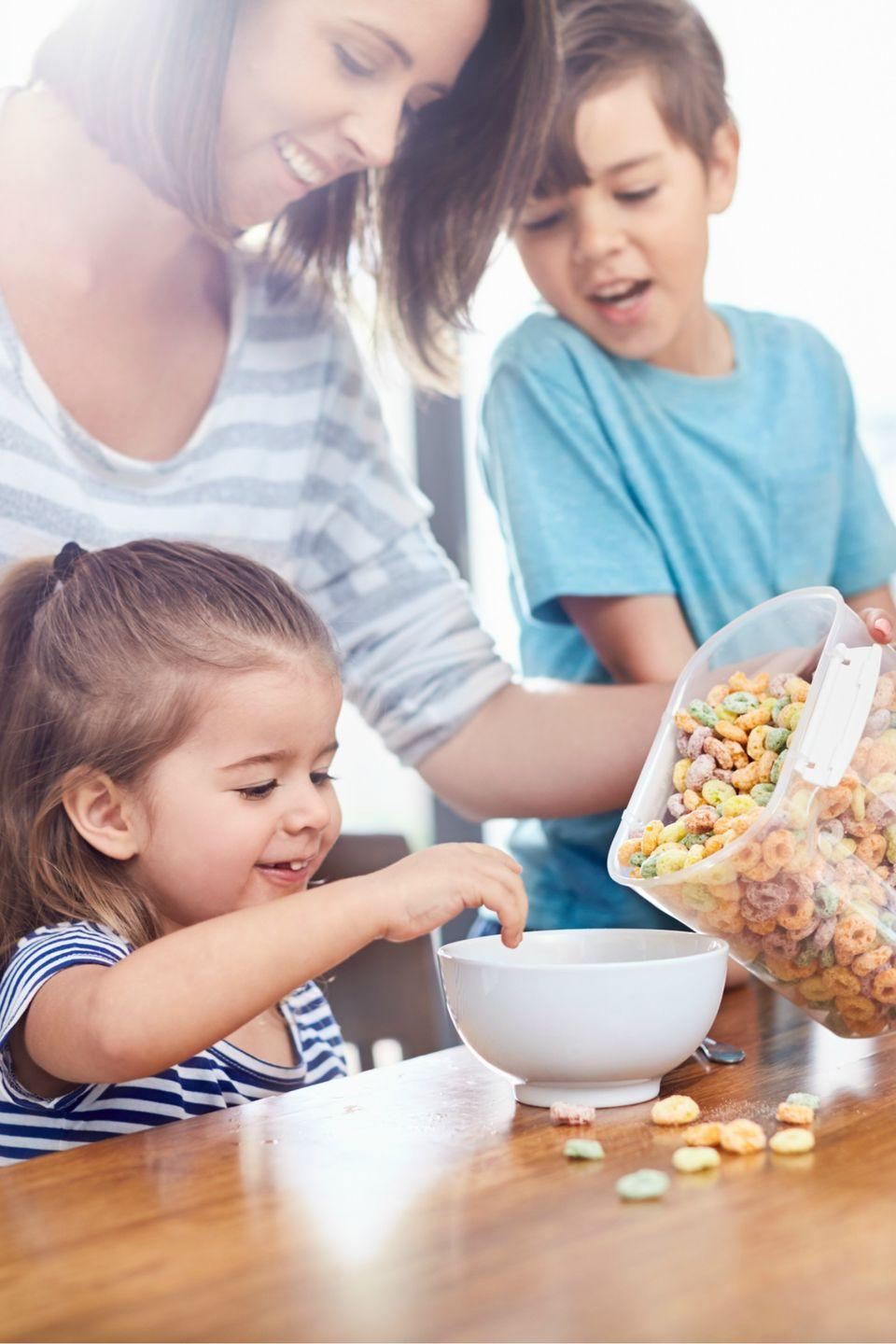 """<p>Move kids' cereal boxes, bowls, and cups to an """"I can reach it!"""" lower cabinet. You can also put juice boxes, milk, and <a href=""""https://www.womansday.com/food-recipes/food-drinks/g2146/after-school-snacks/"""" rel=""""nofollow noopener"""" target=""""_blank"""" data-ylk=""""slk:other snacks"""" class=""""link rapid-noclick-resp"""">other snacks </a>in an accessible place <a href=""""https://www.womansday.com/food-recipes/g22799763/food-not-stored-in-fridge/"""" rel=""""nofollow noopener"""" target=""""_blank"""" data-ylk=""""slk:in the refrigerator"""" class=""""link rapid-noclick-resp"""">in the refrigerator</a>.</p>"""