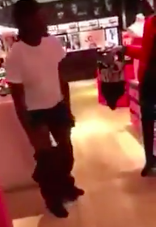 The man is forced to strip in public. Photo: Youtube