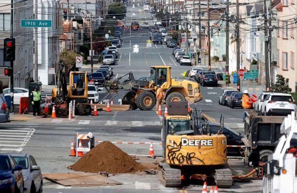 PHOTO: Workers operate a front loader as they make infrastructure repairs, April 7, 2021, in San Francisco. (Justin Sullivan/Getty Images, FILE)