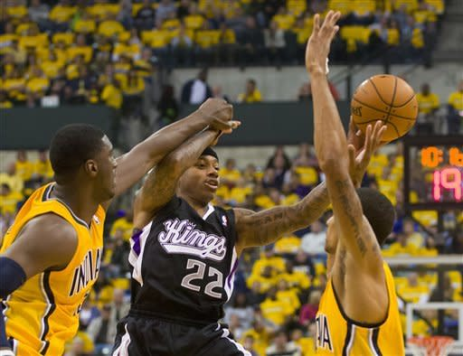 Sacramento Kings' Isaiah Thomas passes off against the Indiana Pacers during the first half of an NBA basketball game in Indianapolis on Saturday, Nov. 3, 2012. (AP Photo/Doug McSchooler)
