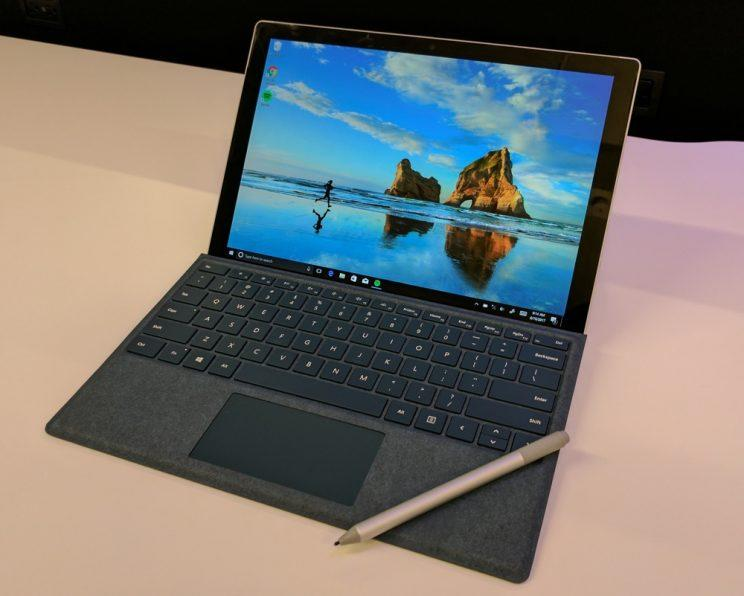 Microsoft Surface Pro with keyboard and pen accessories.
